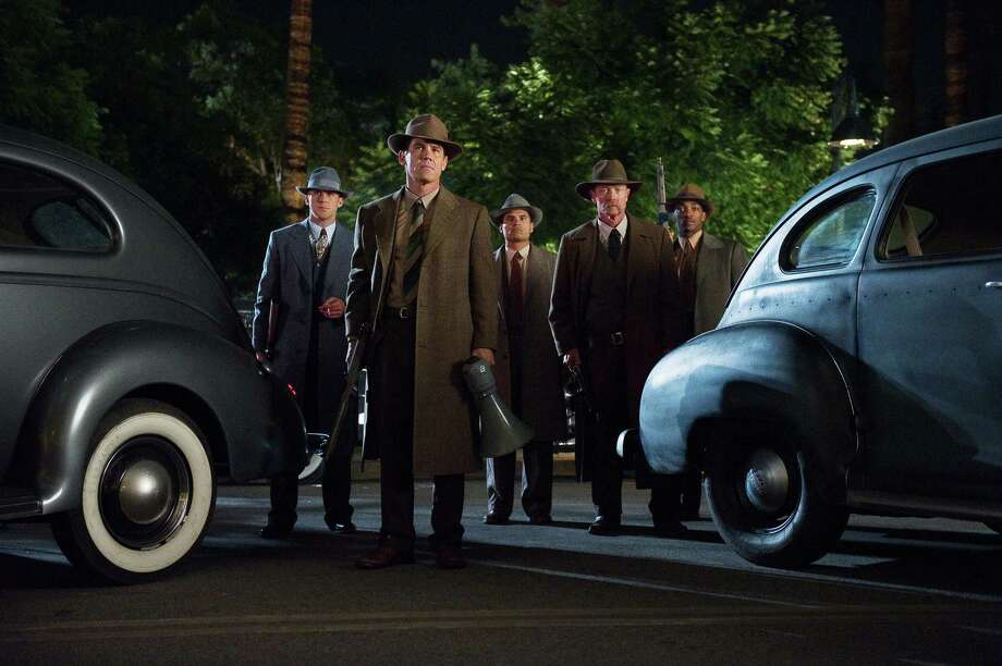 "This undated publicity photo released by Warner Bros. Pictures shows, from left, Ryan Gosling as Sgt. Jerry Wooters, Josh Broslin, as Sgt. John O'Mara, Michael Pena, as Officer Navidad Ramirez, Robert Patrick, as Officer Max Kennard, and Anthony Mackie, as Officer Coleman Harris, in Warner Bros. Pictures' and Village Roadshow Pictures' drama, ""Gangster Squad,"" a Warner Bros. Pictures release. To bring the story of mobster Mickey Cohen's reign over post-war Los Angeles to life, the director of ""Gangster Squad"" employed Sean Penn, Josh Brolin, Ryan Gosling and more than 100 irreplaceable vintage American cars. (AP Photo/Warner Bros. Pictures, Wilson Webb) Photo: Wilson Webb"