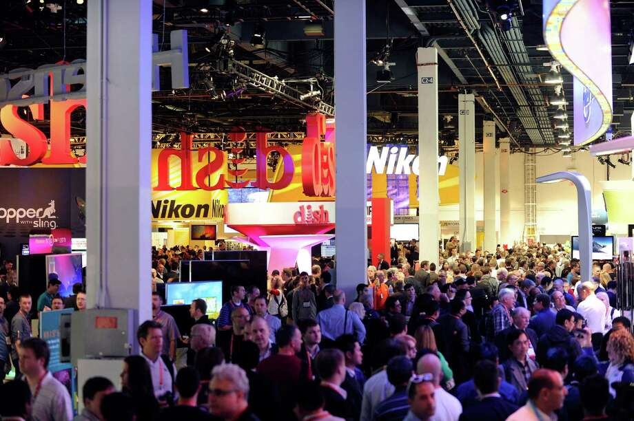 LAS VEGAS, NV - JANUARY 09: Attendees fill the aisles at the 2013 International CES at the Las Vegas Convention Center on January 9, 2013 in Las Vegas, Nevada. CES, the world's largest annual consumer technology trade show, runs through January 11 and is expected to feature 3,100 exhibitors showing off their latest products and services to about 150,000 attendees. Photo: David Becker, Getty Images / 2013 Getty Images