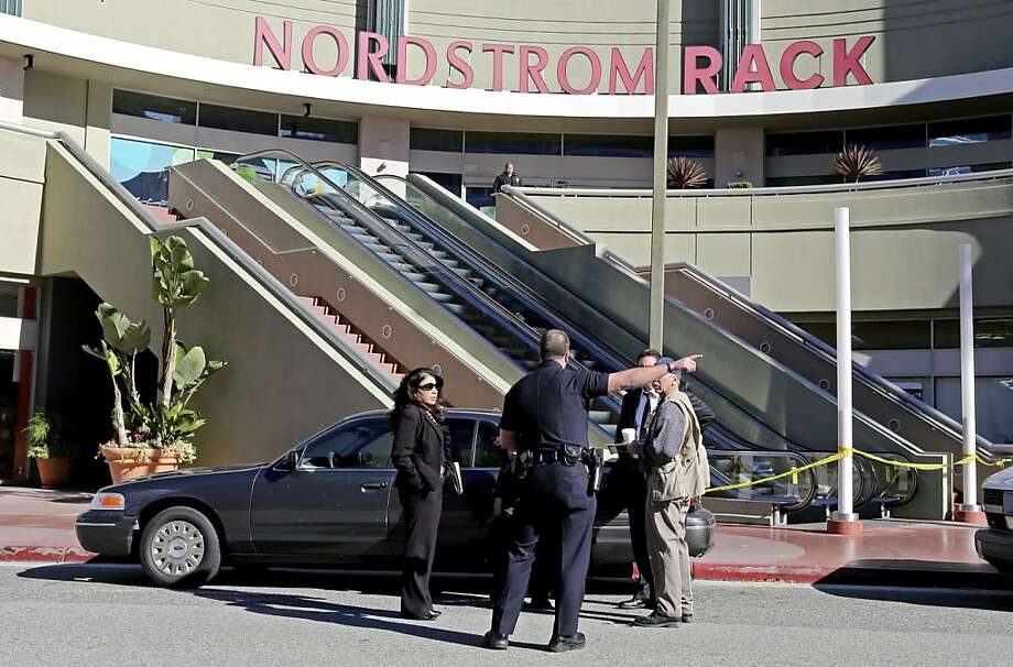 Los Angeles police gather at the Howard Hughes Center Nordstrom Rack, where two gunmen held 14 workers hostage. Photo: Reed Saxon, Associated Press