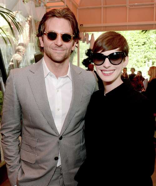 Actors Bradley Cooper (L) and Anne Hathaway attend the 13th Annual AFI Awards at Four Seasons Los An