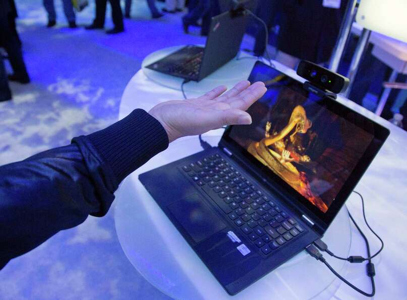 Convention attendees test out Intel's Creative Interactive Gesture Camera development kit at the Con