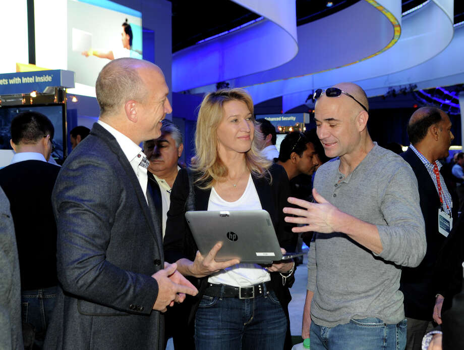 Intel Brand Manager Danny Cristofano, left, guides tennis power couple Steffi Graf and Andre Agassi through the Intel booth as they check out the latest consumer technology and innovative gadgetry Friday. Photo: Handout, Getty Images / 2013 Las Vegas News Bureau