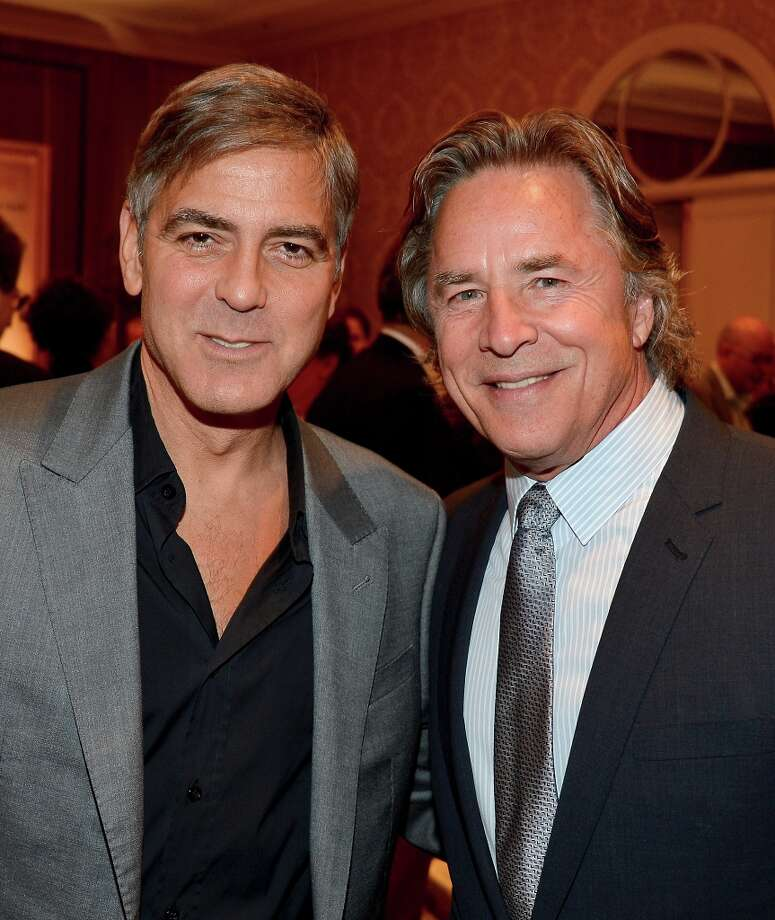 Actor/director George Clooney (L) and actor Don Johnson attend the 13th Annual AFI Awards at Four Seasons Los Angeles at Beverly Hills on January 11, 2013 in Beverly Hills, California. Photo: Frazer Harrison, Getty Images / 2013 Getty Images