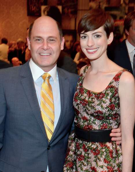 Producer/writer Matthew Weiner (L) and actress Anne Hathaway attend the 13th Annual AFI Awards at Fo