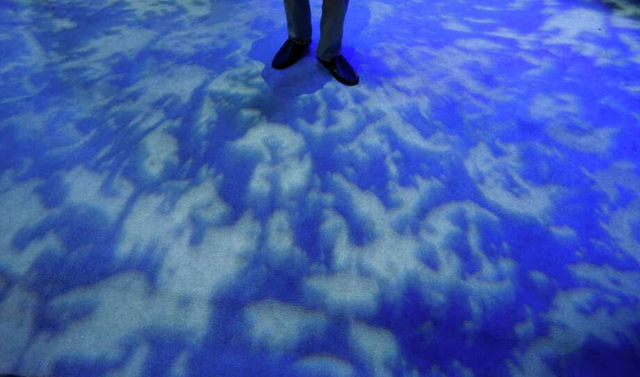 Some patterns are projected on the floor of the Intel booth at the International Consumer Electronics Show in Las Vegas, Thursday. Photo: Jae C. Hong, Associated Press / AP