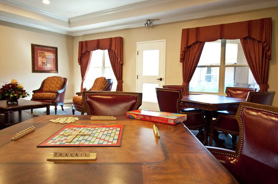 A gathering/game room inside Pelican Bay Assisted Living Community. Photo: Facebook.