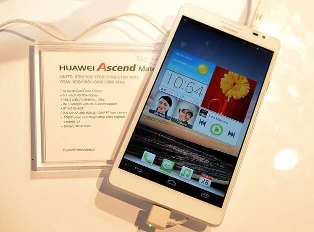 Huawei's Ascend Mate smartphone, at 6.1 inches, is larger than the standard phone and will probably stretch the seams of your pockets. Photo: Joe Klamar, AFP/Getty Images