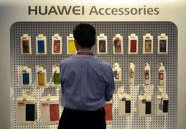 Huawei's phone accessories are displayed at the Huawei booth during the 2013 International CES at the Las Vegas Convention Center on January 10, 2013 in Las Vegas, Nevada. CES, the world's largest annual consumer technology trade show, runs from January 8-11 and is expected to feature 3,100 exhibitors showing off their latest products and services to about 150,000 attendees.AFP PHOTO / JOE KLAMARJOE KLAMAR/AFP/Getty Images Photo: Joe Klamar, AFP/Getty Images