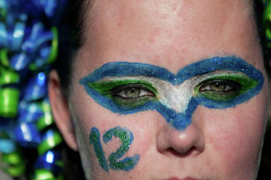 Amanda Baasch of Portland, Oregon show shows her spirit during a sendoff rally for the Seattle Seahawks in Renton on Friday, January 11, 2013. A crowd of hundreds gathered on an Interstate 405 overpass and cheered the team as their buses headed to the airport for the trip to Atlanta and Sunday's playoff game. Photo: JOSHUA TRUJILLO / SEATTLEPI.COM