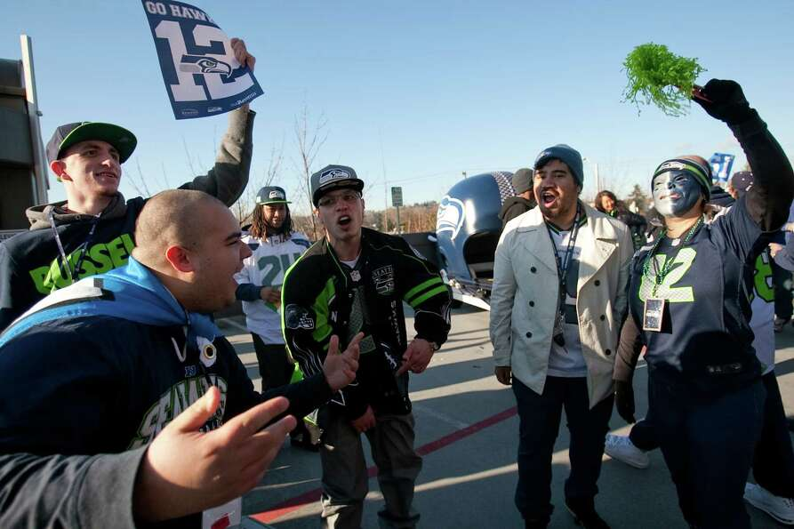 Seahawks fans cheer during a sendoff rally for the Seattle Seahawks in Renton on Friday, January 11,