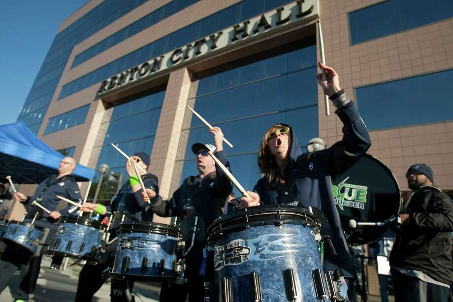 Members of Blue Thunder perform during a sendoff rally for the Seattle Seahawks in Renton on Friday, January 11, 2013. A crowd of hundreds gathered on an Interstate 405 overpass and cheered the team as their buses headed to the airport for the trip to Atlanta and Sunday's playoff game. Photo: JOSHUA TRUJILLO / SEATTLEPI.COM