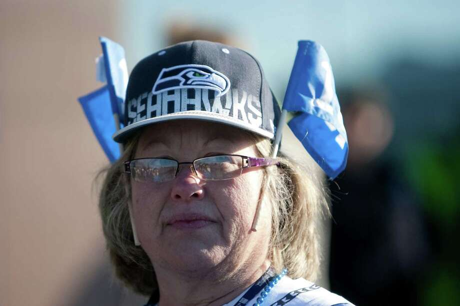 A Seahawks fan shows her spirit during a sendoff rally for the Seattle Seahawks in Renton on Friday, January 11, 2013. A crowd of hundreds gathered on an Interstate 405 overpass and cheered the team as their buses headed to the airport for the trip to Atlanta and Sunday's playoff game. Photo: JOSHUA TRUJILLO / SEATTLEPI.COM