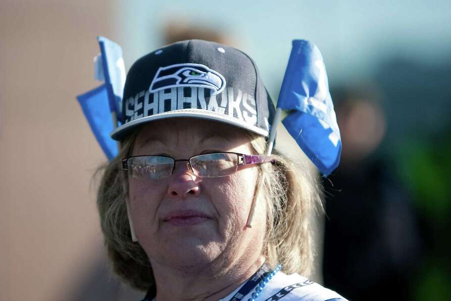 A Seahawks fan shows her spirit during a sendoff rally for the Seattle Seahawks in Renton on Friday,