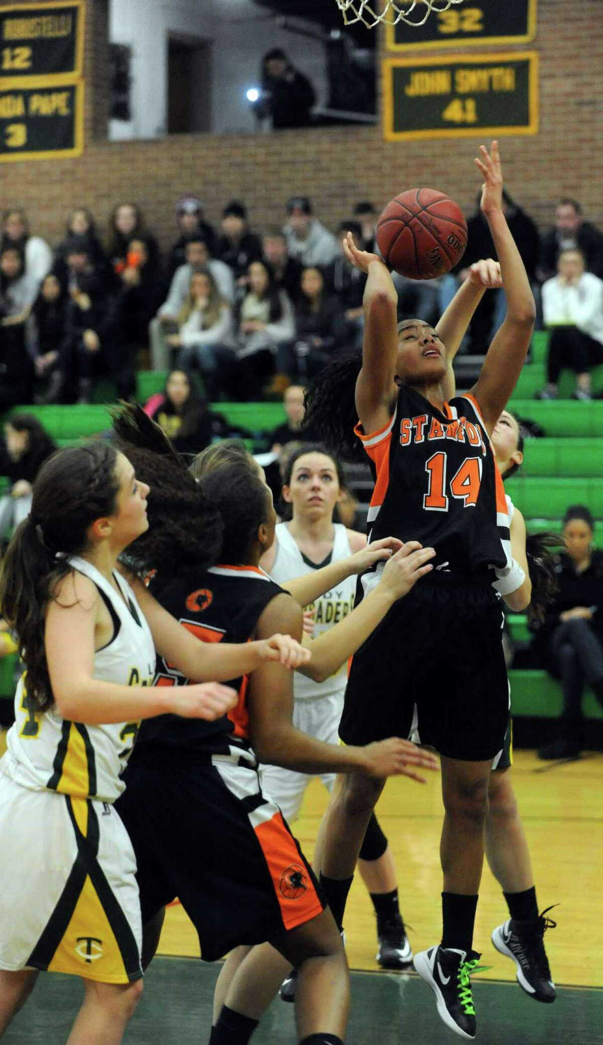 Stamford's Brianna Gordon takes a shot during Friday's girls basketball game at Trinity Catholic High School in Stamford on January 11, 2013.