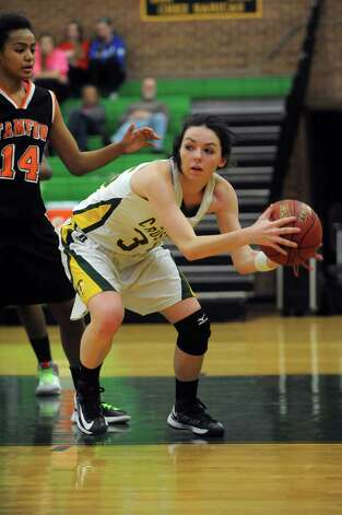 Trinity Catholic's Nicole Fay looks to pass as she is guarded by Stamford's Brianna Gordon during Friday's girls basketball game at Trinity Catholic High School in Stamford on January 11, 2013. Photo: Lindsay Perry / Stamford Advocate