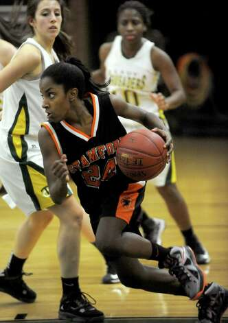Stamford's Tiana England controls the ball during Friday's girls basketball game at Trinity Catholic High School in Stamford on January 11, 2013. Photo: Lindsay Perry / Stamford Advocate