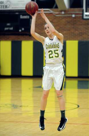 Trinity Catholic's Ali Palma takes a shot during Friday's girls basketball game at Trinity Catholic High School in Stamford on January 11, 2013. Photo: Lindsay Perry / Stamford Advocate