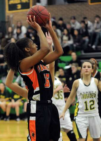 Stamford's Anisa Fortt takes a shot during Friday's girls basketball game at Trinity Catholic High School in Stamford on January 11, 2013. Photo: Lindsay Perry / Stamford Advocate