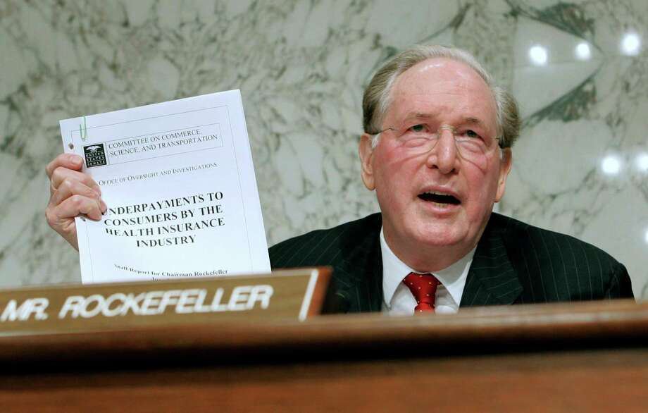 FILE - In this Sept. 29, 2009, file photo Senate Finance Committee member Sen. Jay Rockefeller, D-W.Va., holds up a report about underpayment to consumers during the markup of health care legislation on Capitol Hill in Washington. U.S. Sen. Jay Rockefeller said Friday, Jan. 11, 2012, that he will not seek a sixth term in 2014, a half-century after he emerged from one of America's most recognizable dynasties to land in West Virginia and climb atop its political ranks. (AP Photo/Susan Walsh, File) Photo: Susan Walsh