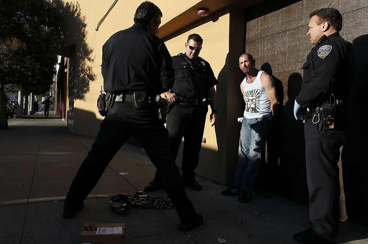 (l to r) Sgt. Troy Carrasco, Officer Mark Hodge and Officer Jordan Oryall, with the San Francisco Police Department out of Southern Station, make an arrest of a burglary suspect on 5th St. near Folsom St. in San Francisco, Calif. on Wednesday Jan. 2, 2013.
