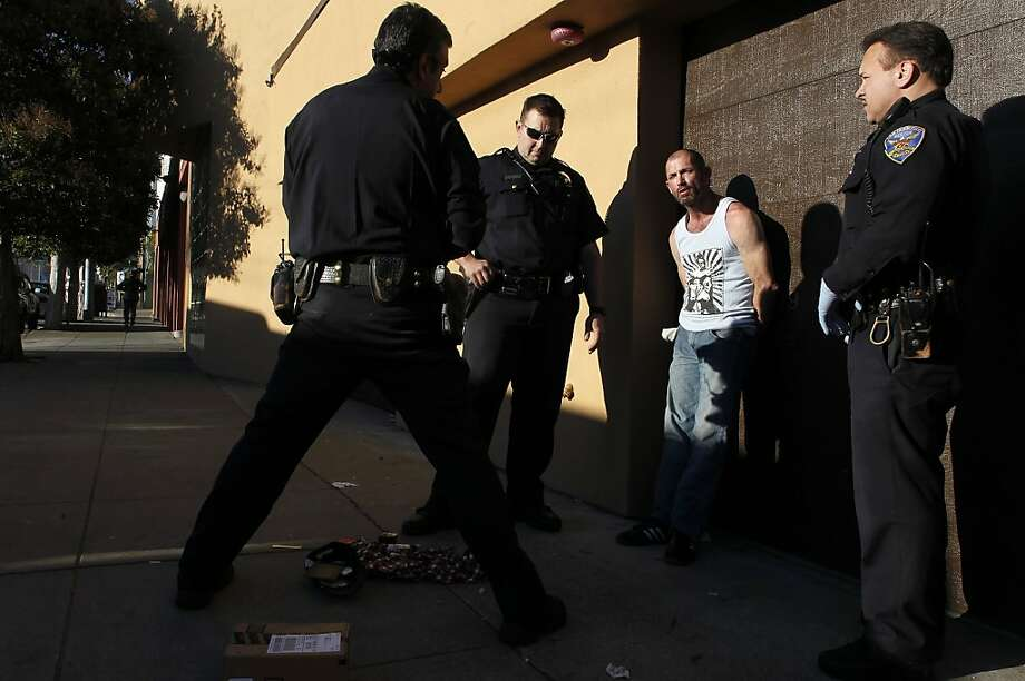 (l to r) Sgt. Troy Carrasco, Officer Mark Hodge and Officer Jordan Oryall, with the San Francisco Police Department out of Southern Station, make an arrest of a burglary suspect on 5th St. near Folsom St. in San Francisco, Calif.  on Wednesday Jan. 2, 2013. Photo: Michael Macor, The Chronicle