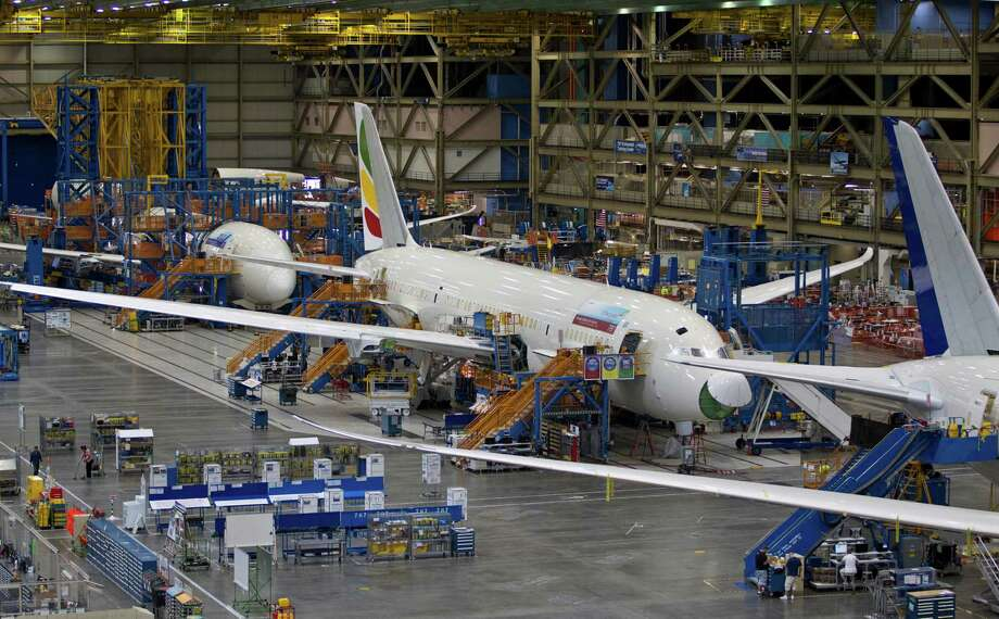FILE - In this Sept. 25, 2011 file photo, Boeing 787s sit at the company's assembly plant in Everett, Wash. The U.S. Federal Aviation Administration announced Friday, Jan. 11, 2013 that the agency is conducting a comprehensive review of the design, manufacture and assembly of the Boeing 787, even while government officials declared the plane safe despite recent incidents including a fire and a fuel leak earlier this week. (AP Photo/John Froschauer, File) Photo: John Froschauer