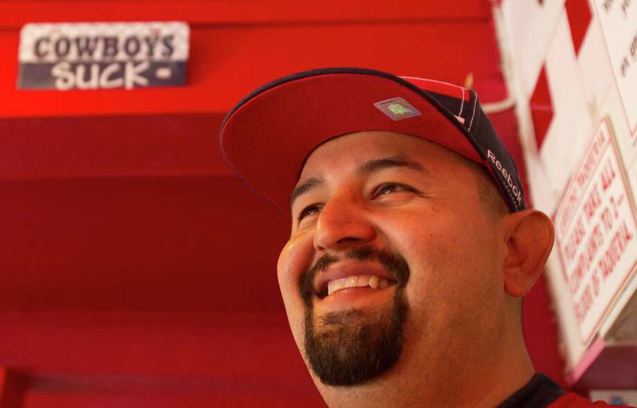 Co-owner of  Laredo Taqueria, Mario Celestino smiles as he waits on customers Friday, Jan. 11, 2013, in Houston. Photo: Cody Duty, Houston Chronicle / © 2012 Houston Chronicle
