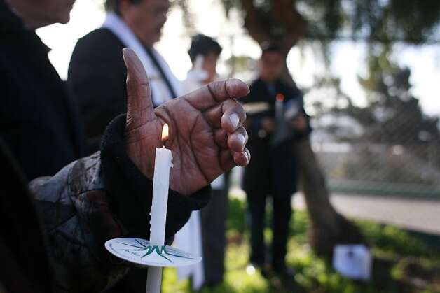 Gertrude Thomasson holds a candle during prayer service for Eric Avila, 52, who was fatally stabbed on New Year's Eve in S.F.'s Potrero Hill neighborhood. Photo: Mike Kepka, The Chronicle