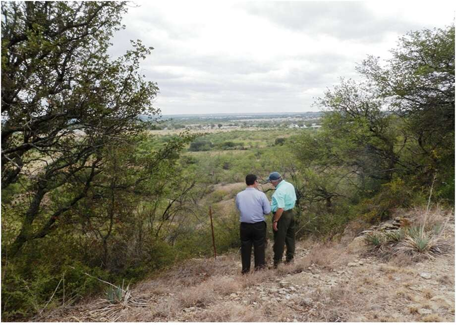 Bryan Geary, left, of OPF Enterprises, and Gary Davis of Brownwood Clay Holdings look over the acreage in Brownwood where Davis says he expects to prove that ordinary clay can be used to make ceramic proppant. Photo: Brownwood Clay Holdings