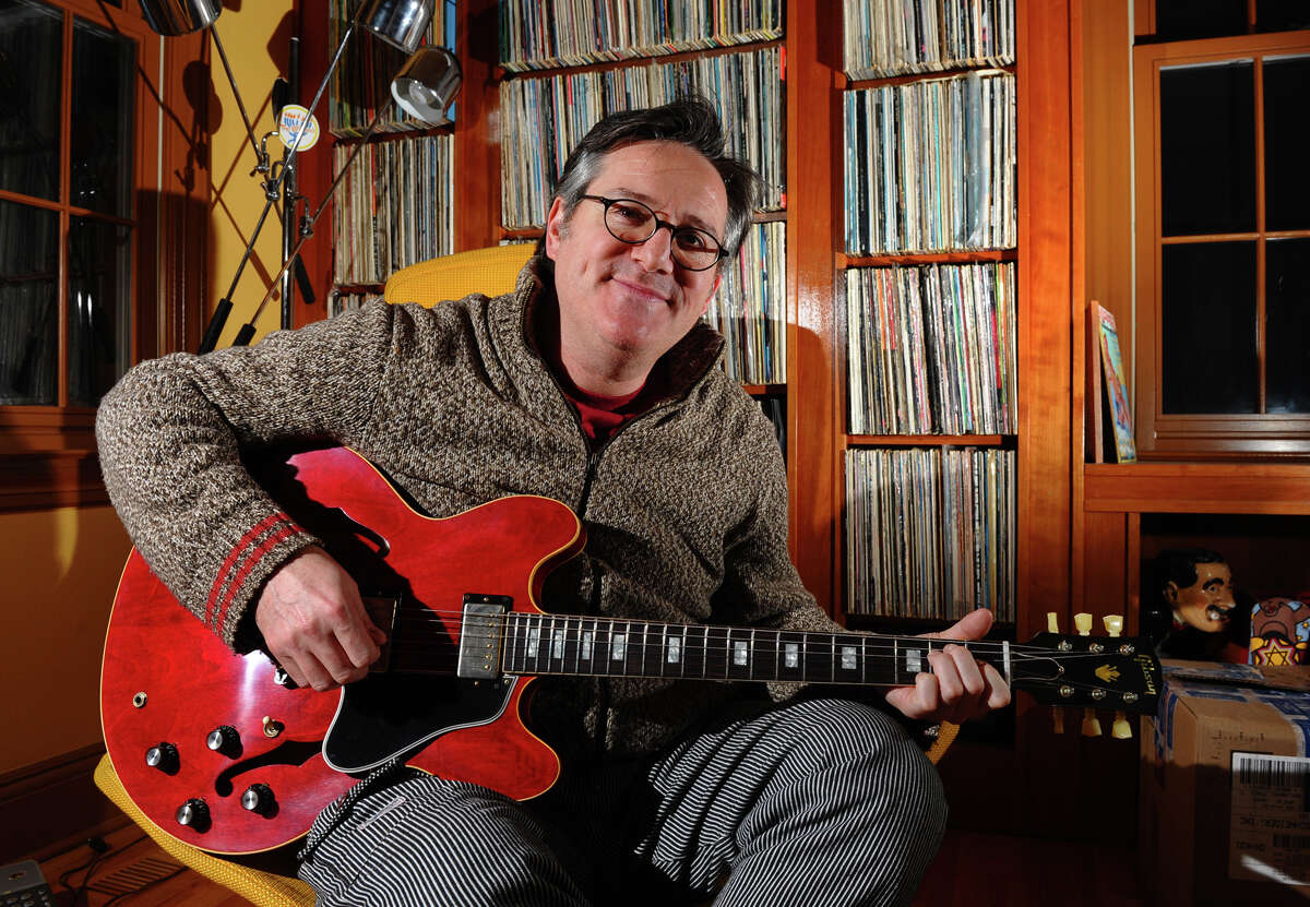 David Schneider poses with his new custom Gibson guitar at his home in Fairfield, Conn. on Thursday January 11, 2013. It was given to him by Gibson after hearing of his plight of a broken Gibson guitar due to baggage handlers at Delta Airlines.