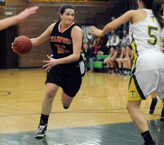 Stamford's Kelsey Santagata controls the ball during Friday's girls basketball game at Trinity Catholic High School in Stamford on January 11, 2013. Photo: Lindsay Perry / Stamford Advocate