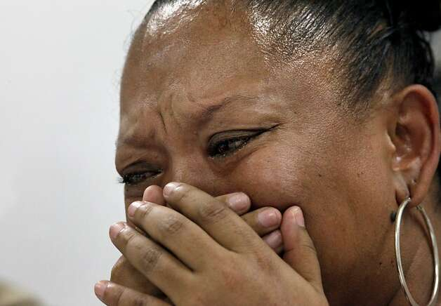 LaTanya Lozano cries as she recounts the killing of her son Shonte Maurice-Corey Daniels Jr., during an interview with a councilor with the Alameda County California Victims Compensation Program, Monday April 23, 2012, in Hayward, Calif.  Shonte Maurice-Corey  Daniels Jr. was 15 years old when he was killed coming home from a party by who he thought was a friend. Photo: Lacy Atkins, The Chronicle