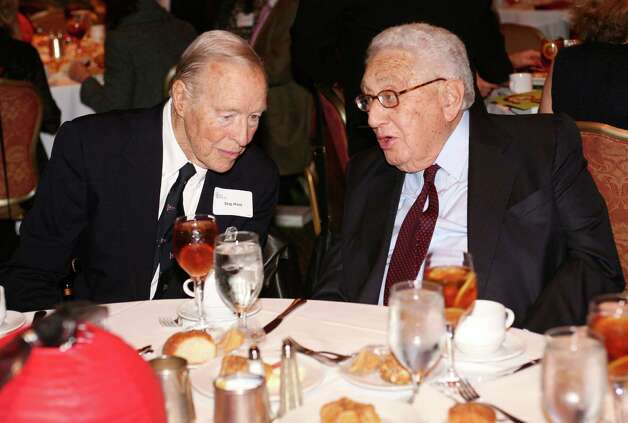 Former Secretary of State Dr. Henry Kissinger, right, speaks with Stig Host during Kissinger's appearance at a Family Centers benefit luncheon at the Hyatt Regency Greenwich Nov. 4, 2011. Host, an international oil and shipping executive, mutual fund director, recipient of the Daughters of the American Revolution's 2004 Americanism Medal and a champion of the environment, died Jan. 9 at his Greenwich home. He was 86. Photo: David Ames / Greenwich Time