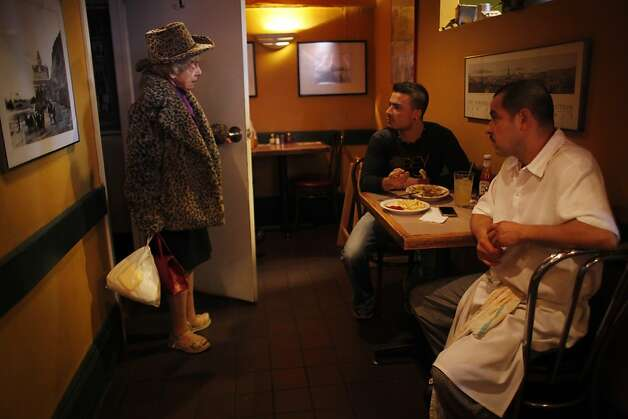 "After her sister Vivian passed away earlier this week, San Francisco twin Marian Brown breaks the news to some of the staff at Uncle Vito's pizza on Jan. 11, 2013 in San Francisco, Calif. ""I can't believe she's gone. Its the saddest day of my life,"" said Marian Brown about her sister. Vivian was 85. Photo: Mike Kepka, The Chronicle"