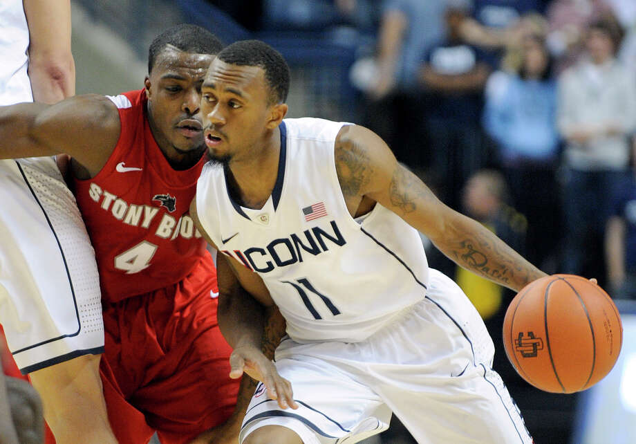 Connecticut's Ryan Boatright, right, drives past Stony Brook's Anthony Jackson during the second half of Connecticut's 73-62 victory in an NCAA college basketball game in Storrs, Conn., Sunday, Nov. 25, 2012.  (AP Photo/Fred Beckham) Photo: Fred Beckham, Associated Press / FR153656 AP