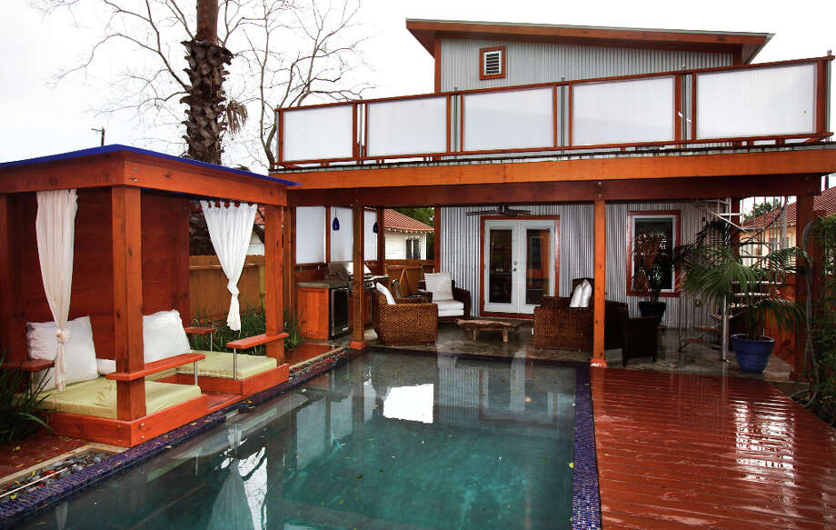 The back yard at the home of Trey and Kimberly Mannix on W. Ashby, has been converted to an entertaining pool area.  Wednesday Jan. 9, 2013. Photo: Bob Owen, San Antonio Express-News / ©2013 San Antonio Express-News