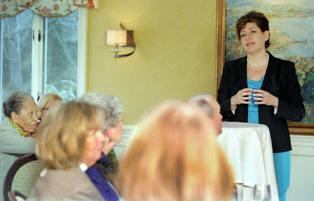Susan Herbst, president of the University of Connecticut, speaks to a gathering sponsored by the Ridgefield League of Women Voters, at Sarah's Wine Bar in Ridgefield, Friday, January 11, 2013. Photo: Carol Kaliff / The News-Times