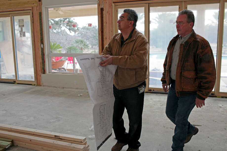 Designer Michael Cortez, left, and Vision Design and Build Project Manager Jim Pearson look over plans at a house under renovation in the Cordillera Ranch subdivision east of Boerne, Monday, Jan. 7, 2013. Photo: Jerry Lara, San Antonio Express-News / © 2013 San Antonio Express-News