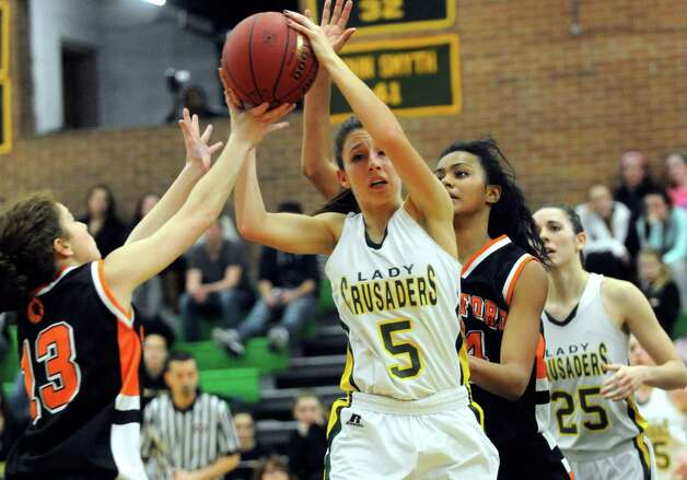 Trinity Catholic's Kellie Hurd controls the ball during Friday's girls basketball game at Trinity Catholic High School in Stamford on January 11, 2013. Photo: Lindsay Perry / Stamford Advocate