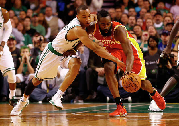 Celtics guard Avery Gradley applies pressure on defense against Rockets shooting guard James Harden. Photo: Jared Wickerham / 2013 Getty Images