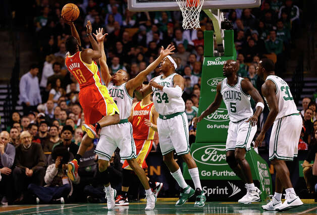Rockets shooting guard James Harden shoots over the Celtics' defense. Photo: Jared Wickerham / 2013 Getty Images