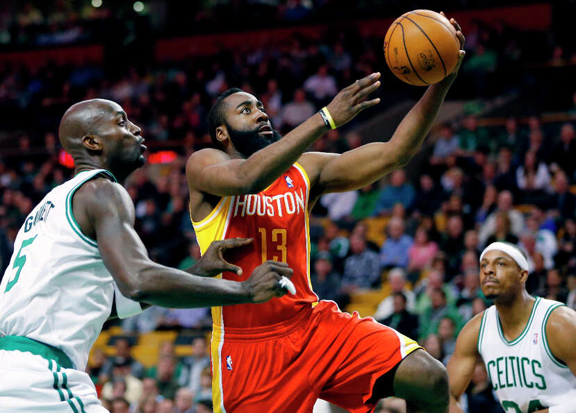 Rockets shooting guard James Harden attempts a shot over Celtics forward Kevin Garnett.