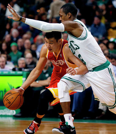 Rockets point guard Jeremy Lin attempts to drive past Rajon Rondo of the Celtics. Photo: Michael Dwyer