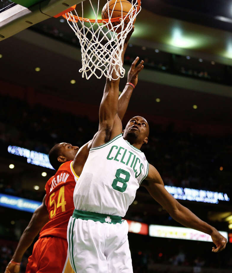 Celtics forward Jeff Green dunks the ball over Patrick Patterson of the Rockets. Photo: Jared Wickerham / 2013 Getty Images