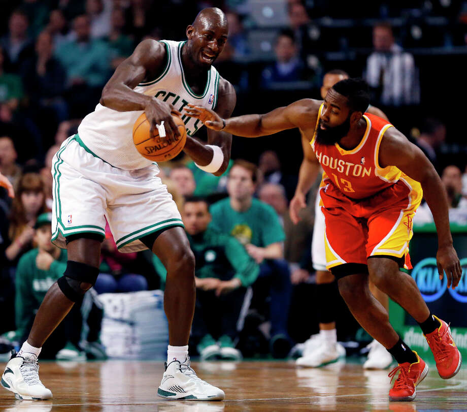 Rockets shooting guard James Harden tries to knock the ball from Kevin Garnett of the Celtics. Photo: Michael Dwyer