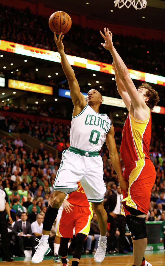 Celtics guard Avery Bradley attempts a shot over Omer Asik of the Rockets. Photo: Jared Wickerham / 2013 Getty Images