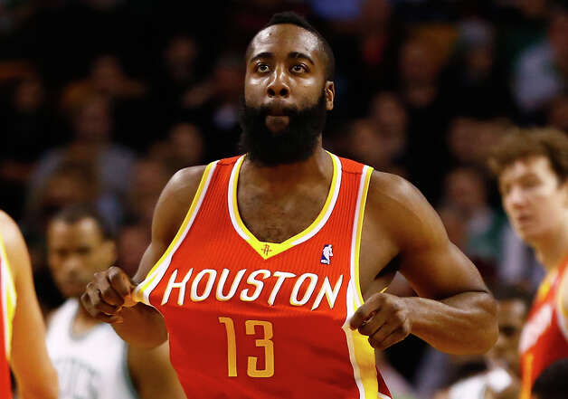 Rockets shooting guard James Harden straightens his jersey after being fouled against the Celtics. Photo: Jared Wickerham / 2013 Getty Images