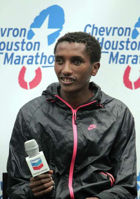 Elite marathon runner Bazu Worku speaks during the 2013 Chevron Houston Marathon Pre-race Press Conference at the George R. Brown Convention Center Friday, Jan. 11, 2013, in Houston. ( James Nielsen / Chronicle ) Photo: James Nielsen, Staff / © Houston Chronicle 2013
