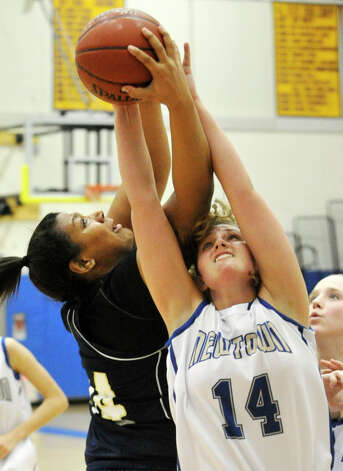 Lauralton Hall's Olivia Levey battles Newtown's Maddy Good for a rebound during their game at Newtown High School on Friday, Jan. 11, 2013. Lauralton Hall won, 50-44. Photo: Jason Rearick / The News-Times