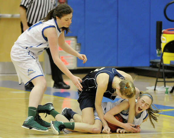 Newtown's Sam Steimle, left, comes to the assistance to her teammate, Sarah Lynch, who is guarding the basketball from Lauralton Hall's Emma McCarthy during their game at Newtown High School on Friday, Jan. 11, 2013. Lauralton Hall won, 50-44. Photo: Jason Rearick / The News-Times